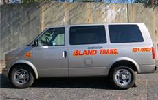 Mid Island Taxi Corp's Gray van