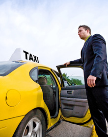 Male driver opening the door of the taxi